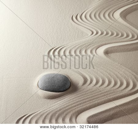 zen buddhism spiritual japanese rock garden abstract harmony and balance concept for purity concentration spirituality meditation tao spa therapy relaxation sand and stone