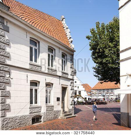 Lingen, Germany, 27 August 2019: Boy Near Market Place Of German Town Lingen In Lower Saxony On Sunn