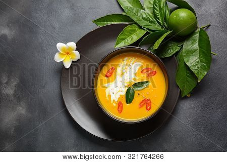 Thai Spicy Pumpkin And Coconut Milk Soup With Kaffir Lime Leaves , Red Chili And Galangal Roots Powd