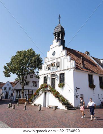 Lingen, Germany, 27 August 2019: Two Women Near Old Town Hall Of Lingen In German Town Off Lower Sax