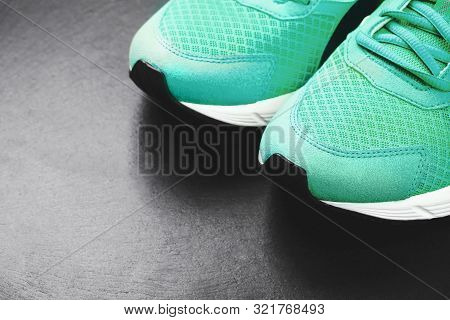Green Sneakers On Black Background. Concept Of Healthy Life.