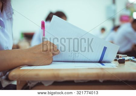 Exams Test Student In School, University Students Holding Pencil For Testing Exam Writing Answer She