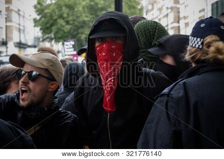 London, United Kingdom, August 3rd 2019:- Anti Fascist Demonstrators March In Opposition To A Rally