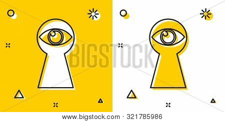 Black Keyhole With Eye Icon Isolated On Yellow And White Background. The Eye Looks Into The Keyhole.