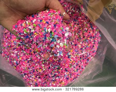 Crushed Plastic Granules For Recycling.  Plastic Crusher. Recycled Plastic With Mixed Colors. The Co