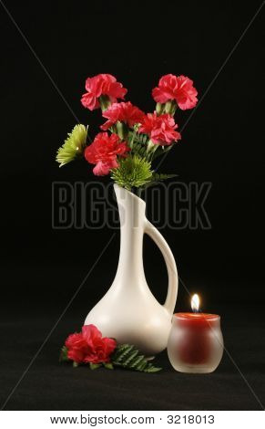 Carnations In White Vase &  Candle