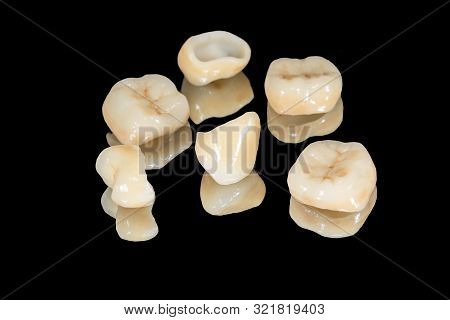 Zirconium Tooth Crown Macro. Isolate On Black Background. Aesthetic Restoration Of Tooth Loss