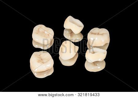 Ceramic Dental Crowns And Veneers. Isolate On Black Background Close-up. Dental Laboratory