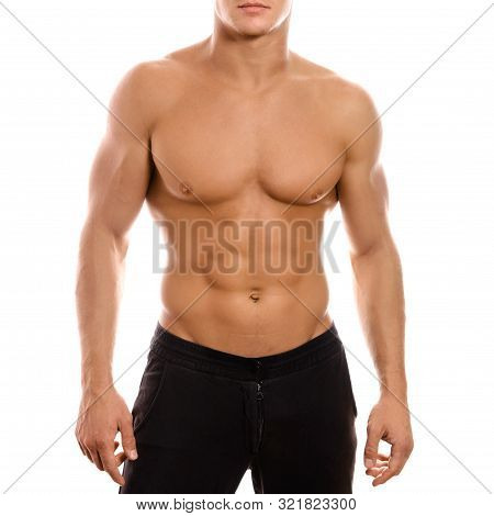 Young Sexy Muscular Macho Man Posing With Naked Torso On White Background
