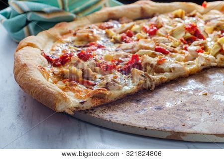 New York Style Specialty Pizza Pie With Balsamic Chicken Sundried Tomatoes And Artichoke Heart Toppi