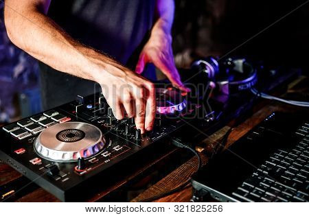 Dj Plays Live Set And Mixing Music On Turntable Console At Stage In The Night Club. Disc Jokey Hands