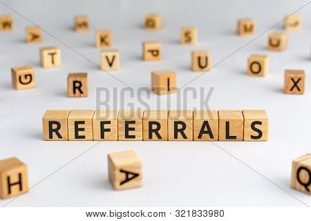 Referrals - Word From Wooden Blocks With Letters, Spreading Referral Viral  Marketing Concept, Rando