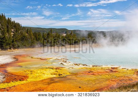 Steam Rises From The Grand Prismatic Spring In Yellowstone National Park. It Is The Largest Hot Spri