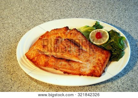 Plate Of Broiled Salmon From Diner, Cooked To Perfection