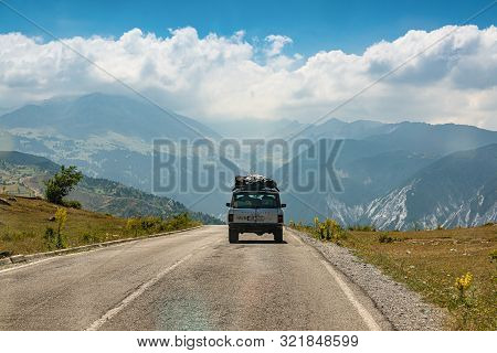 Kolesjan, Albania - July 25, 2019. Vintage Off Road Car Heading To The Mountain In National Park Lur