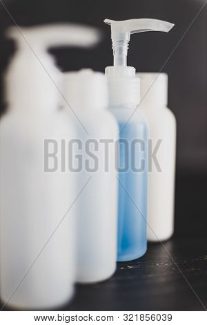 Beauty Lotions And Moisturizers Bottles With Only One Being Colorful