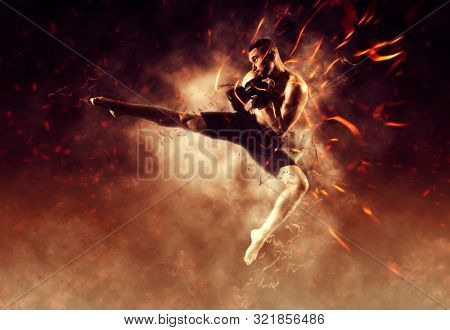 Mixed martial arts fighter (MMA) jumping with a knee kick. Flames background