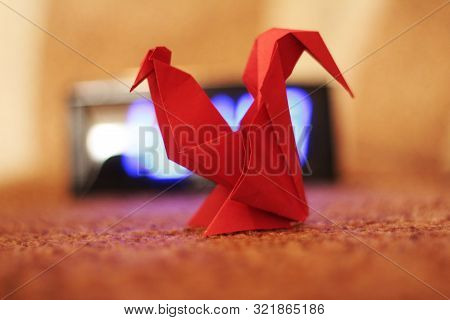 Red Rooster Made Of Paper On Brawn Background