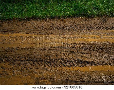Brown Slush And Mud On The Road. Impassable Mud. Traces Of Trucks