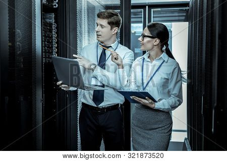 Two Security Guards In Eyeglasses Working Together With The Laptops