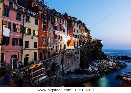 Village Of Riomaggiore In Cinque Terre Illuminated At Night, Italy