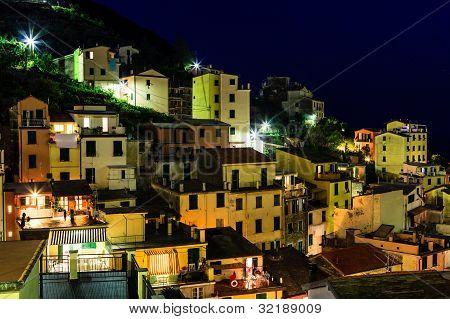 Aerial View On Illuminated Village Of  Riomaggiore At Night, Cinque Terre, Italy