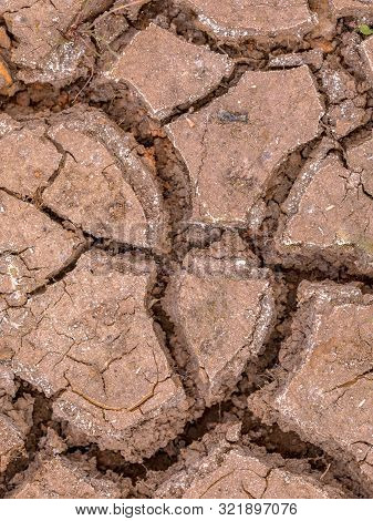 Cracked Soil Caused By Drought As Concept For Climate Change And Famine