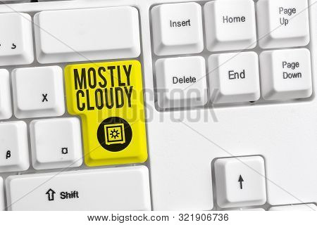 Handwriting text Mostly Cloudy. Concept meaning Shadowy Vaporous Foggy Fluffy Nebulous Clouds Skyscape White pc keyboard with empty note paper above white background key copy space. poster