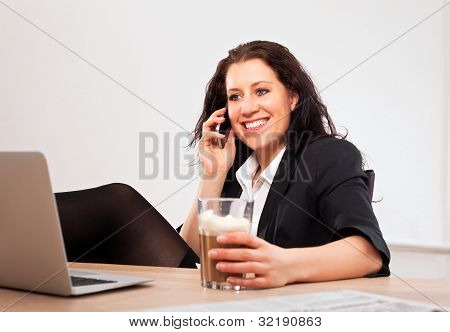 Smiling Executive Talking On The Phone