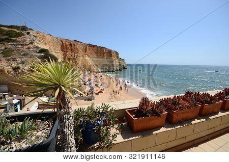 Beachgoers At Benagil Beach, Algarve, Portugal During The Summer