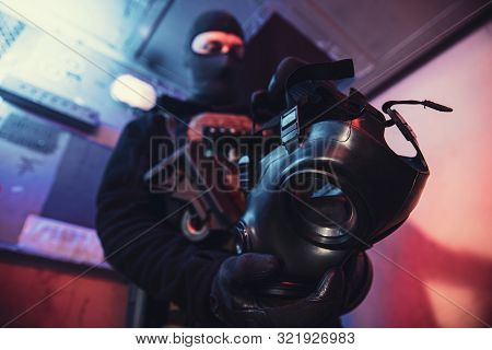 Gas Mask In Hand Of Special Unit Soldier