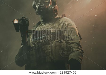 Special Force Soldier Between Smoke And Dust At Battlefield