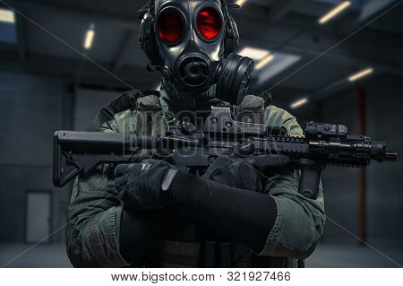 Brave Military Man In Gasmask Is Holding His Machine Gun