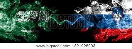 Saudi Arabia Kingdom Vs Slovenia, Slovenian Smoky Mystic Flags Placed Side By Side. Thick Colored Si