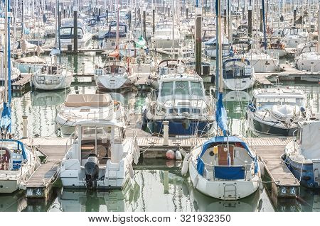 Crowded Boating Marina With Lots Of Yachts And Small Pleasure Craft - No Product Identification Or N