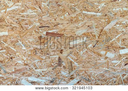 Flay Lat View Of Osb Wood Veneer Background. Osb Board Made Of Brown Wood Chips Sanded Into A Wooden
