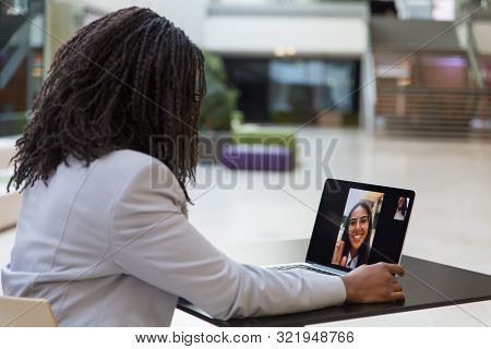Young Businesswoman Using Laptop. African American Businesswoman Sitting At Table With Laptop Comput