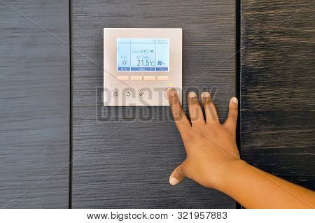 African Woman Hand Try To Turn On The New Air Condition In Room, In The Hotel Room. African  Female
