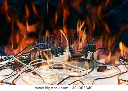 Concept Of Electrical Short Circuit. Electro Wires On Fire. Electric Network Overload, Fire Hazard