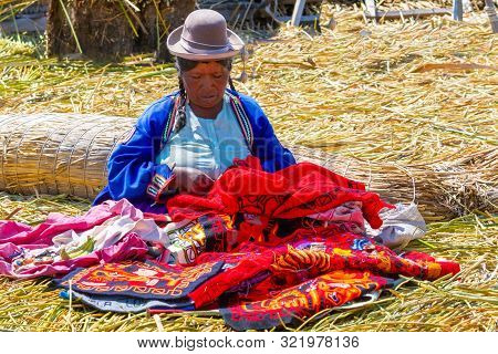Titicaca Lake Peru, August 16 Portrait Of A Woman In Traditional Clothes Working On One Of The Islan