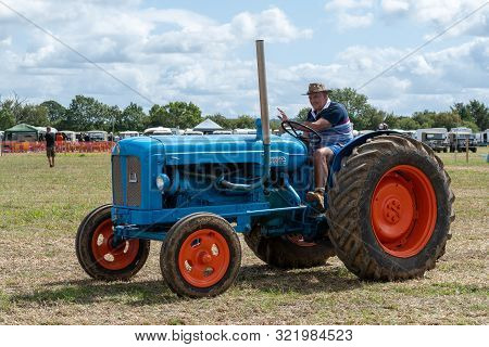 Haselbury Plucknett.somerset.united Kingdom.august 18th 2019.a Fordson Major Is Being Driven Around