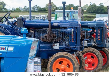 Haselbury Plucknett.somerset.united Kingdom.august 18th 2019.a Row Of Vintage Tractors Are Being Dis