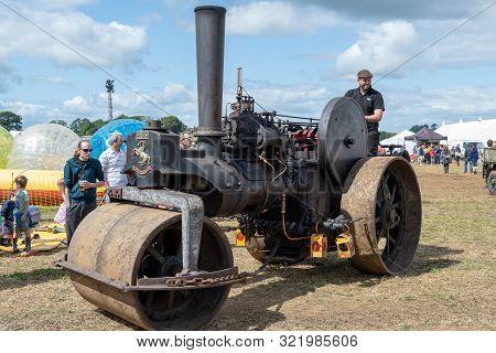 Haselbury Plucknett.somerset.united Kingdom.august 18th 2019.a Restored Vintage Steam Roller Is Bein