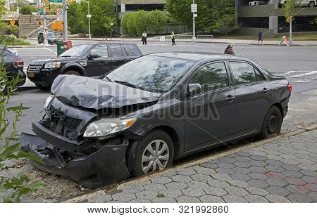Bronx, New York/usa - May 6, 2019: Vehicle Parked On Curb Shoiwing Damage From A Wreck.