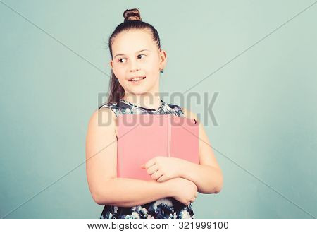Keeping Her Secrets In Diary. Child Cute Girl Hold Notepad Or Diary Blue Background. Childhood Memor
