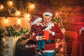 Adore his son. Magic atmosphere family holidays. Fatherhood joy. Enjoy every moment with his son. Winter holidays concept. Spend holidays together. Father and baby son celebrate christmas at home. poster