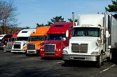 Truck trailers on rest area along american Interstate 95 poster