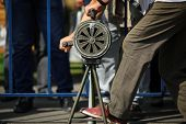 Shallow depth of field image with a man handling a vintage hand crank air raid siren poster