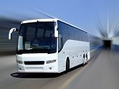 A white tour bus set against a motion blurred background poster