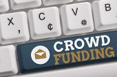 Word writing text Crowd Funding. Business concept for Fundraising Kickstarter Startup Pledge Platform Donations White pc keyboard with empty note paper above white background key copy space. poster